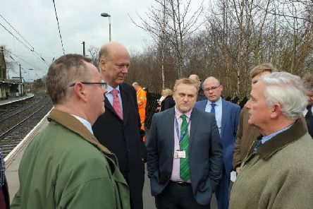 Transport Secretary Chris Grayling with Northumberland county councillors during the journey on part of the line where it is hoped to reintroduce passenger rail services.