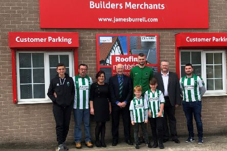 Left to right: Rebecca Davison, Kevin Scott, Robbie Dale, Andy Lees, and members of community at the opening of the new look James Burrell Builders Merchant in Blyth.