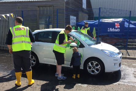 Even the youngest volunteer helped Blyth RNLI at their fundraising car wash. Picture by Robin Palmer