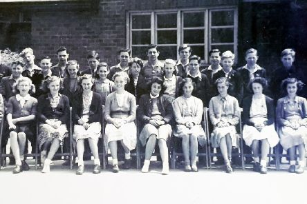 Winifred Cleverly nee Hall - who lived in Swansfield Park Road prior to her moving to Cornwall is pictured fourth from the right on the bottom row..