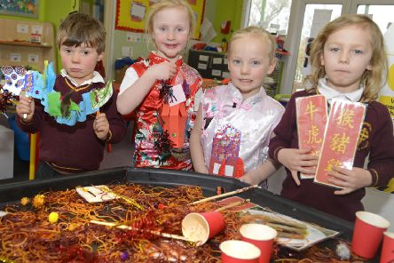 Ben, Naomi, Florence and Teddi celebrate Chinese New Year at Whittingham Primary School. Picture by Jane Coltman