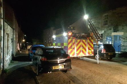 Northumberland Fire and Rescue tackle the chimney fire at a house on Holy Island. Picture courtesy of Holy Island Coastguard.