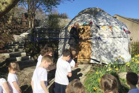 Simon Taylor, CEO of The Three Rivers Learning Trust, cuts the ribbon on the new yurt at Harbottle C of E (Aided) First School.