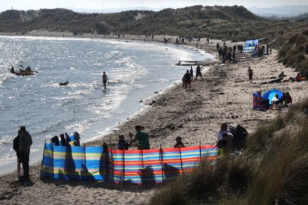 Beadnell Bay was a popular spot over the Easter weekend.' Picture by Jane Coltman