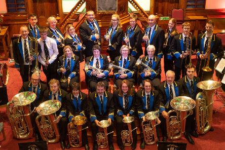 Band shines in new uniforms