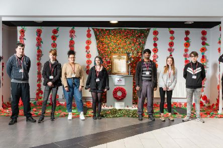 Burnley College students in front of the Remembrance memorial they created.