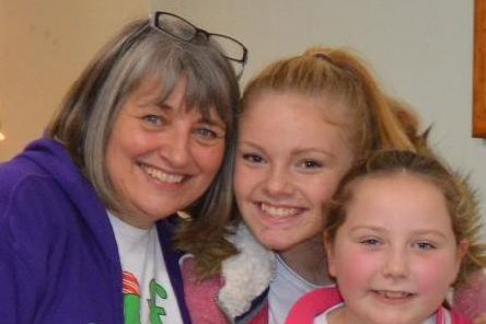 Julie Scott, who has retired after a career spanning 43 years with as a teaching assistant, with her granddaughters, Olivia and Isabelle.