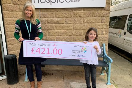 Hollie Wilkinson presents a cheque to the hospice's Jo Applegate