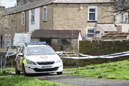 Police at the scene in the outskirts of Burnley town centre