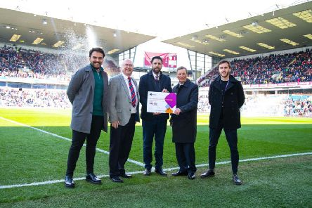Tom Conway, Premier League Kicks Manager at Burnley FC in the Community;  Steve Clarke Provincial Grand Charity Steward for East Lancashire freemasons; Neil Hart, Chief Executive Officer of Burnley FC in the Community, John Farrington, Deputy Provincial Grand Master for the East Lancashire Masonic Province and Michael Colquhoun, Head of Young Peoples Services, Burnley FC in the Community.