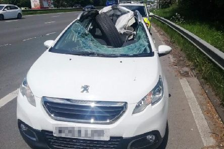 This Peugeot has been written off after being crushed by a 22.5 inch tyre which became detached from a lorry on the M6.