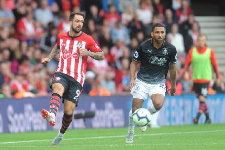 Former Claret Danny Ings lays the ball off as Aaron Lennon looks on during last seasons Premier League opener at Southampton