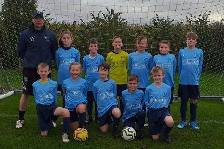The Stamford Bridge Under 11s football team pose for a photo in the new kit.