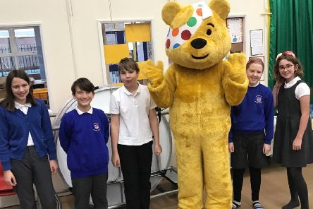 Children at Warter Primary School with Pudsey Bear.