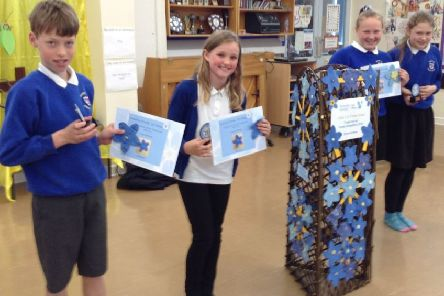 Warter Primary School pupils with their certificates, presented as part of the Dementia Friendly East Riding event.