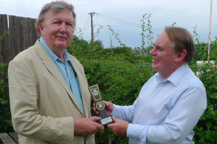 MP Sir Greg Knight is presented with his award by Lord Kirkhope of Harrogate.