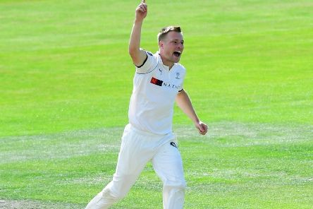 Matthew Waite celebrates taking a wicket for Yorkshire against Lancashire.