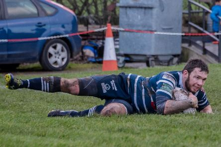 Danny Glassell dives over for the match winning try for Featherstone Lions in their Coral Challenge Cup tie against Underbank. Picture: Jonathan Buck