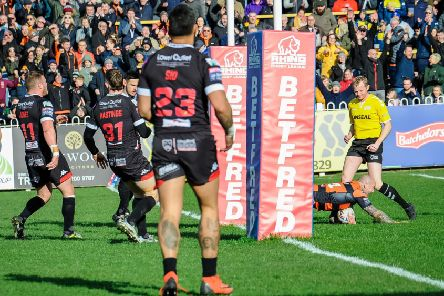 Nathan Massey dives over for a try for Castleford Tigers against Salford Red Devils. Picture: James Heaton