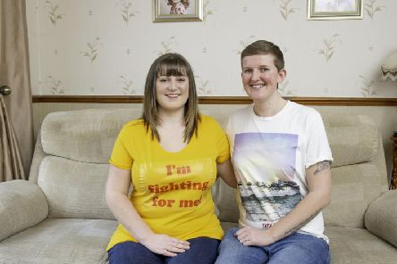 Rebecca Marcon, pictured with her wife Emily, wants to raise awareness of endometriosis.