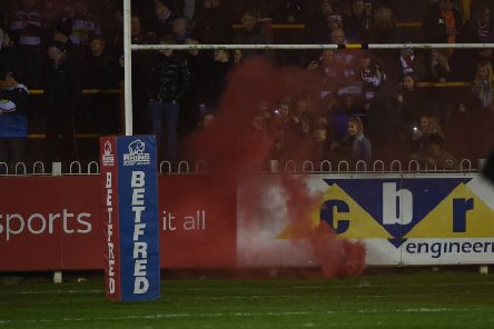 A smoke bomb goes off at Castleford Tigers' game against Wigan Warriors at the Mend-A-Hose Jungle. Picture: Matthew Merrick
