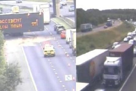 Large tailbacks are hitting the M1 motorway after a crash closed two lanes.