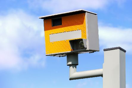 ADOBE STOCK'UK static speed or safety camera against a blue sky
