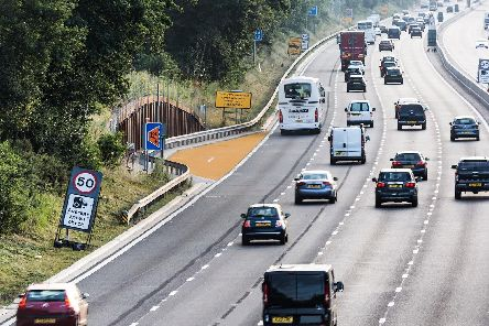 An emergency refuge area on smart motorways which are being painted orange