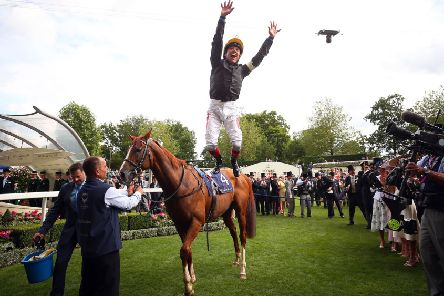 Frankie Dettori treats the crowd to his trademark flying dismount after winning the Gold Cup at Royal Ascot on Stradivarius (PHOTO BY: Bryn Lennon/Getty Images)