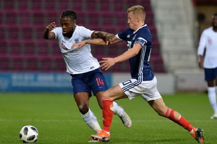 GLASGOW, SCOTLAND - OCTOBER 16: Joshua Onomah of England is challenged by Ross McCrorie of Scotland during the 2019 UEFA European Under-21 Championship Qualifier between  Scotland U21 and England U21 at Tynecastle Stadium on October 16, 2018 in Glasgow, Scotland. (Photo by Mark Runnacles/Getty Images)