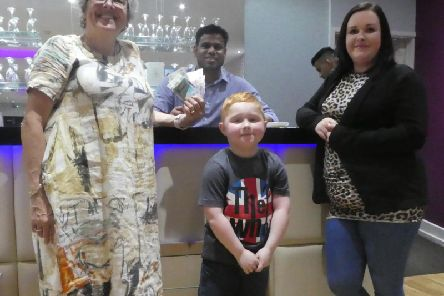 Dylan Lowman with mum Ashley and Pamela Fabianska, at a fundraising evening  the Curry Lounge Somercotes.