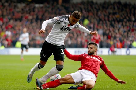 NOTTINGHAM, ENGLAND - NOVEMBER 09: Jayden Bogle of Derby County and Tiago Silva of Nottingham Forest compete for the ball during the Sky Bet Championship match between Nottingham Forest and Derby County at City Ground on November 09, 2019 in Nottingham, England. (Photo by Getty Images/Getty Images)