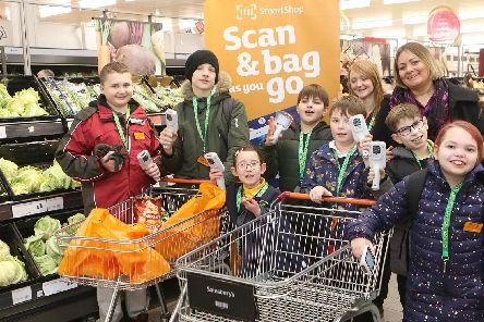 Pupils from Alfreton Park School, try shopping during the new Sunflower Hour quiet period at Sainsburys Ripley