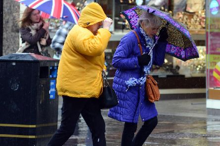 Lunchtime shoppers struggle against high winds