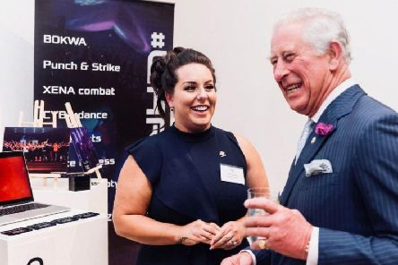 Dominique with the Prince of Wales.