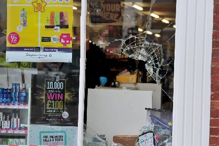 A window was smashed during the burglary. Picture: Gerard Binks.