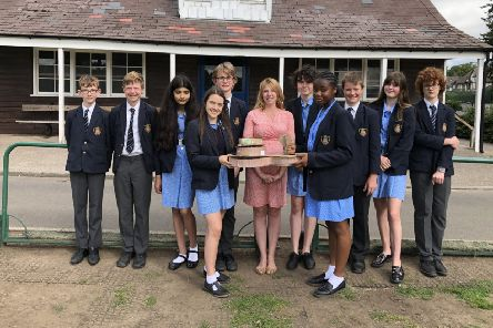 Ripon Grammar School students with the design of the modern cricket pavilion, with the ancient beech tree taking pride of place.