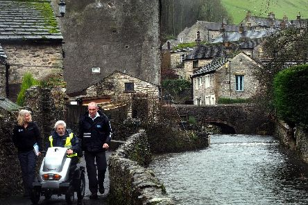 Miles Without Stiles launch in Castleton: Sue Smith, John Cuthbertson and Geoff Lomas on the Castleton Peak route through the back alleys of Castleton