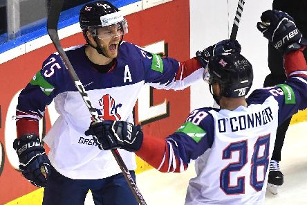 Great Britain's forward Robert Dowd, left, celebrates with defender Ben O'Connor