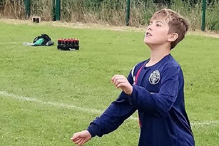 Harrison Walch, aged 14, playing football for Aston Swallonest Boys Blue. He is receiving cancer treatment at theCancer andLeukaemiaWard at Sheffield Children's Hospital.
