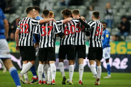 Newcastle's players celebrate against Macclesfield in the last round.
