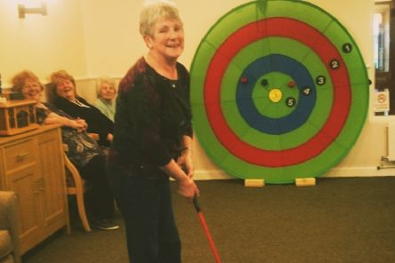 Residents at Frank Bushell House enjoying Rookie Golf.