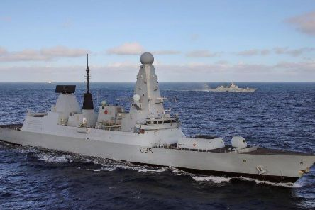 HMS Defender, armed to the teeth with spinny things and a spiky ball.