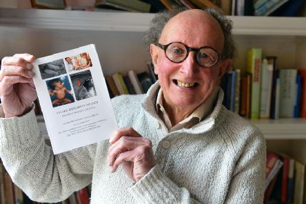 Retired surgeon Ian Rogers with his book.