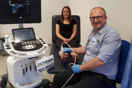Musculoskeletal Podiatrists Peter Morgan and Lindsey Deary with the new ultrasound machine