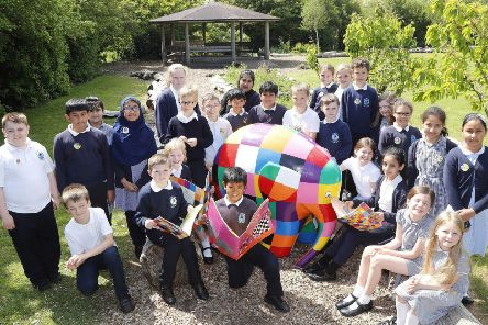 Elmer's Great North Parade begins in August, pupils at Hadrian Primary School with the Elmer the Elephant statue.