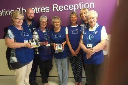 Friends present the music players to Chris Reynolds, senior operating department practitioner, second from left, and theatres administrator Lesley Steadman, second from right