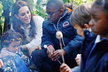 The Duchess of Cambridge toasting marshmallows with local schoolchildren at RHS Chelsea. Picture by RHS/Luke MacGregor