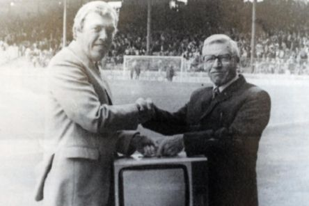 Roy Ashton is presented with a television from Fred Walters after he won 2nd prize in the weekly draw.  Picture: NSST-28-01-19-Ashton-5