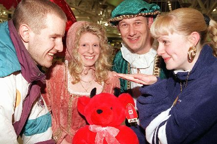 """NEWS....10/2/99'Would you Adam and Eve it? Shoppers Shelley Roberts (right), aged 18, and Phil Benson, aged 19, both of Belle Vue, exchange glances over a shopping trolley at the Doncaster Asda store which held a Valentine's night on Wedneday (10/2/99). Looking on are the store's very own """"Romeo and Juliet"""",  Keith Shaw and Gail Parkin.  sat"""